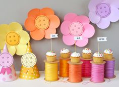 Cute as a Button Party. The spools are made from cans!