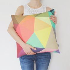 We love this geometric pillow cover. The pastel colors are perfect for spring!