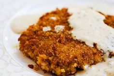 Pork Schnitzel ~ Thinly pounded breaded pork cutlets, browned and served with a creamy dill sauce. ~ SimplyRecipes.com