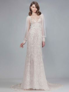 Victoria KyriaKides blush wedding dress with detailed sparkly beaded overlay, lace appliques and loose sheer long sleeves Fall 2016 | https://www.theknot.com/content/victoria-kyriakides-wedding-dresses-bridal-fashion-week-fall-2016