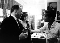 Frank Sinatra and Natalie Wood visit Sammy Davis, Jr. in his dressing room after a performance of Golden Boy. Photo by John Dominis, 1965.