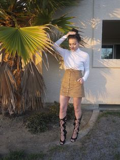 """I tucked this sweater in and paired it with a laced front high heel making this a perfect outfit for a sunset dinner!"" -Cameron Samurai of The Girls Guide, in an H&M faux suede skirt. 