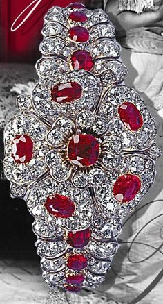 Queen Mary's Ruby Diamond Bracelet-Brooch. A wedding gift when she married the Duke of York in 1893. It is a ruby and diamond bracelet incorporating a detachable centerpiece in the shape of a rose. Queen Mary presented this bracelet to Elizabeth II as a wedding gift in 1947. crown jewelry, diamond braceletbrooch, mari rubi, rubi diamond, queen mari, silver bracelets, queen mary, diamond bracelets, wedding gifts