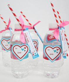 """Guest Project — """"Love Juice"""" Valentine's Day Gift Idea {with free printable}!!  a bottle of water  Hawaiian punch singles   a roll of heart wrapping paper,    scrapbook paper will work too.  avery file folder labels #48366  card stock for heart labels  ribbon  paper straws  tape.   (I will try finding Duck Tape with Hearts on it)."""