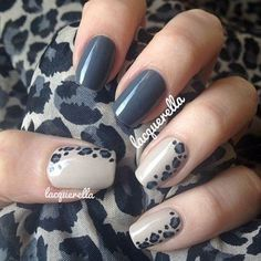 Dark gray animal prints nail art design. A strong looking nail art design with matter dark gray polish plus white polish under a series of black and dark gray animal prints painted on top.