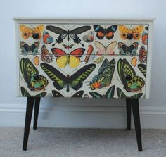Give old furniture a new look by either stenciling or adding decals to it.  This piece would be a centerpiece in any room.