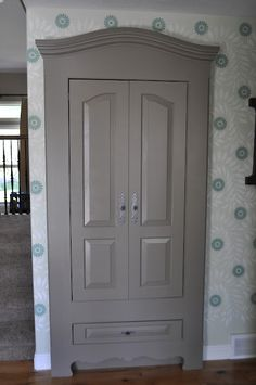 Hall closet...faux armoire :) Love this idea!