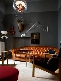gray walls, leather couch