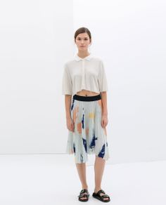 Love this for Spring. Image 1 of PLEATED PRINT SKIRT from Zara