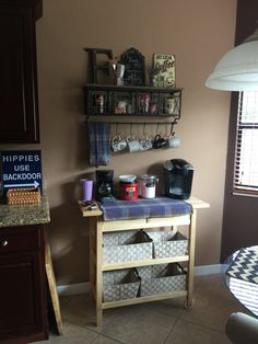 My new coffee bar...finally! Pinterest inspired, of course. The famous Hobby Lobby shelf, bronze letter and signs, also from Hobby Lobby, and a Forhoja Kitchen Cart from IKEA.