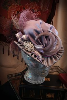 i like the pointed brim, the fullness through the crown. it's elaborate and interesting yet clean and simple