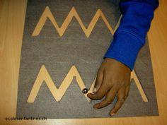 // L'apprentissage pré-braille // les lignes brisées creusées ds du carton (parcours avec billes)