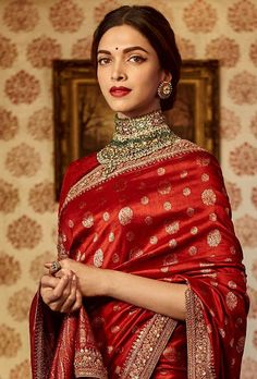 Deepika Padukone in 'The Sabyasachi Red' Benares Revival Saree from our Heritage Collection. Photo Courtesy : Nilaya by Asian Paints. Indian Bridal Outfits, Indian Fashion Dresses, Indian Designer Outfits, Indian Bridal Fashion, Sabyasachi Sarees, Lehenga Choli, Deepika In Saree, Red Saree, Bollywood Saree