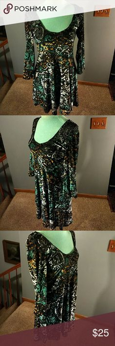 """Free People Dress Black rayon and polyester blend dress with multiple floral design on it has a scoop neck line in front elastic around the cuffs has never been worn 33"""" long Free People Dresses"""