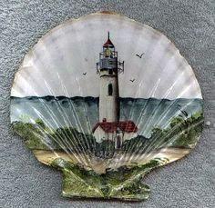 Sandy Knodel artwork - seashell with yaquina lighthouse painted on it.