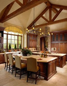 I can't even believe this kitchen exists. It's HUGE, with two islands, amazingly high ceilings and big, beautiful windows. I want this!