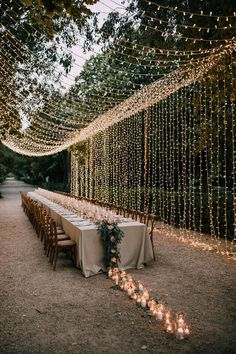 How stunning is this country chic wedding look. Combine rustic fairylights with a trail of candles that lead down your wedding tables for the ultimate wedding decoration idea. Visit Hitched for more wedding decor looks and ideas