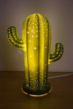 This cactus lamp is succulent! Who doesn't love a good cactus pun, right? This lamp is made of porcelain and will illuminate your space, while giving it a fun Southwest-inspired vibe. Made of porcelain x x Green Cactus, Cactus Flower, Cactus Light, Cactus Cactus, Indoor Cactus, Glass Cactus, Lampe Cactus, Deco Cactus, My New Room