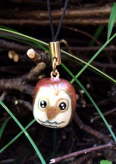 Polymer clay glow-in-the-dark owl charm in its native habitat. Look for him on Etsy really soon! ^_^