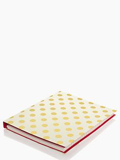 put a little pep in your work day with our classic spiral notebook in gold polka dots. with 224 lined pages, it's fit to hold your day's worth of lists and doodles, and will pack a punch next to your floral skirt.