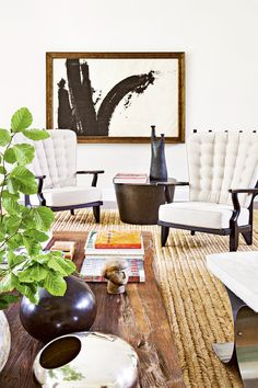 Tour a Gorgeously Layered, Artistic Hamptons Home// abstract, tufted chairs, seagrass rug