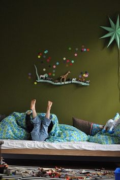 Green wall, painted stick, dots and animals