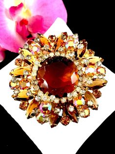 FOR YOUR KIND CONSIDERATION, A SENSATIONAL JULIANA D&E GOLD-TONE FINISH CIRCULAR FLORAL DESIGN SPRAY BROOCH PIN, COMPLETED WITH GORGEOUS SMOKED TOPAZ RHINESTONES AND FINISHED WITH CRYSTAL AURORA BOREALIS CHATON RHINESTONES IN A SPRAY DESIGN. | eBay!