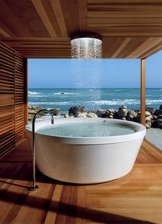 Gorgeous Zucchetti Kos Geo 180 freestanding bathtub in outdoor wooden bathroom with amazing ocean view. Beautify Your Modern Bathroom Design With These Modern Zucchetti Faucets, Showers, And Tubs Dream Homes, My Dream Home, Dream Big, Future House, My House, House Porch, House Front, Farm House, Beautiful Homes