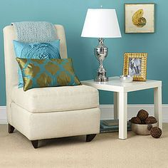 """Perfect for living room. Now I just have to get that chair, make pillows and buy rest of the stuff.  Oxford throw (51"""" x 71"""" ), $27; overstock.com. Blue pillow, $17, patterned pillow, $13, and lamp (28"""" H), $20; all at HomeGoods. Framed print (11½"""" x 11½""""), $20 each; at Pier 1 Imports. Photo frame (5"""" x 7""""), $7; at T.J. Maxx. Bowls, $10 and $30; Kohls. Lack table (215/8"""" L x 215/8"""" W x 173/4"""" H), $8; at Ikea."""