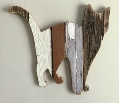 This calico cat is made from repurposed weathered barn wood.