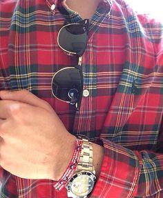 Polo Ralph Lauren Plaid Shirt. Rolex. Ray-Ban Clubmaster sunglasses.
