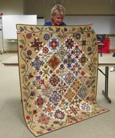 Donna showing her beautiful quilt from a Lori Smith pattern Love it, love it love it!!!!!!