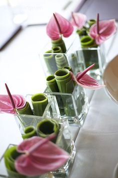 Wrapped/Rolled Banana Leaves + A Single Lily in each Arrangement. (Lily Color options: Pink, White, Red, etc.):