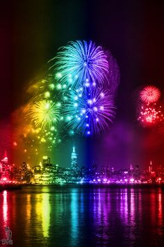 Smile - Who can resist the sight and sounds of these colorful, sizzling fireworks? A burst of color high in the sky, and a multitude of color reflecting in the water below - lovely.