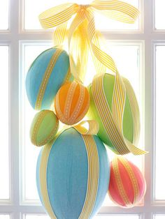 A tumble of pastel eggs is an Easter craft for kids that makes a cheery welcome at the front door. Wrap plastic foam egg shapes (available at crafts supply stores) with strips of crepe paper, attaching ends with glue or a small straight pin. Embellish with ribbon secured using small straight pins, leaving a long end for tying. Gather eggs at varying heights and tie ribbons together. Hang from a removable adhesive hook or wreath hanger, and add a ribbon bow to complete the Easter decoration.