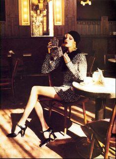 Nadja Auermann photographed by Ellen Von Unwerth edited by Grace Coddington for US Vogue September 1994.