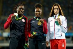 (L-R) Silver medalist, Brittney Reese of the United States, gold medalist, Tianna Bartoletta of the United States, and bronze medalist, Ivana Spanovic of Serbia, pose on the podium during the medal ceremony for the Women's Long Jump on Day 13 of the Rio 2016 Olympic Games at the Olympic Stadium on August 18, 2016 in Rio de Janeiro, Brazil.