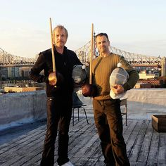 "Rhys Ifans (Mycroft) and Jonny Lee Miller (Sherlock) do some stick-fight training in between takes on ""Elementary."""