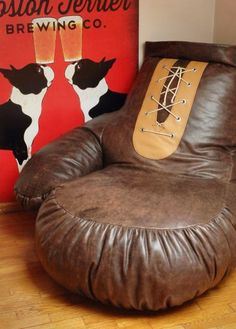 The Boxing Glove Bean Bag Chair is a giant bean bag chair that is made to look exactly like a boxing glove. Made from genuine cow leather, the boxing glove chair is perfect for boxing lovers, boxers, ...