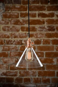 Beautiful copper and glass cone shade industrial pendant light. Handmade in the U.S.A. with top quality components. Glass measures 9 inches in