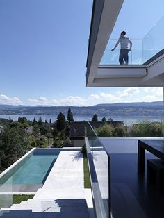 Love this contemporary glass deck. Good thing it is not super high!
