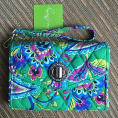 """Vera Bradley Your Turn Smartphone Wristlet~NWT Vera Bradley Your Turn Smartphone Wristlet~Emerald Paisley • Larger all-in-one phone case and Wristlet • Silver-toned turnlock closure • inside gusseted interior, four separate compartments (one designed especially for a smartphone), three card slips, plus zippered coin pocket • Will accommodate larger phones, including iPhone 6 or Samsung Galaxy S4 • Removable wrist strap Size:  6 1/4"""" W x 4 1/4"""" H x 1 1/4"""" D with 6"""" wrist strap  SMOKE FREE…"""