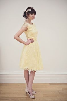 The pale lemon yellow fearne lace tea dress.