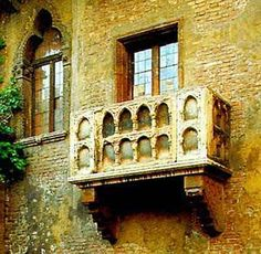 Small marble balcony on Juliet's House, once owned by the Capulet family, made famous by verses in Shakespeare's tragedy, in which Romeo declares his love for Juliet as she stands on this balcony. It probably dates back to the 13th century, and has a brick façade with large trilobate windows. Verona - Italy