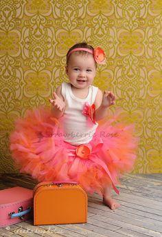 Strawberrie Tangerine Tresor Tutu, Baby Tutu, Petti Tutu, Birthday Tutu, Baby Photo Props, Set with matching Flower Clip and Shirt. $68.95, via Etsy.