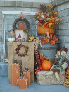 fall porch - like the wooden pumpkins!