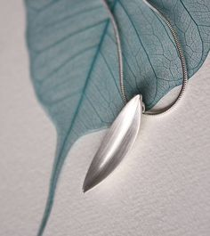 80b8b0438 narrow silver leaf pendant by louise mary designs | notonthehighstreet.com Leaf  Jewelry, Leaf