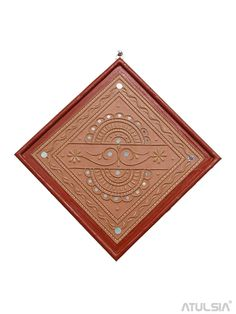 The handmade wall hanging frame is carved on mud base by the Kutch artisan. The wall hanging is beautifully embellished with mirror work. It is suitable for home decor. Handmade Wall Hanging, Wall Hanging Crafts, Hanging Frames, Frames On Wall, Clay Wall Art, Mirror Wall Art, Mirror Mosaic, Diy Mirror, Indian Art Traditional