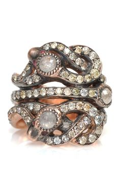 Unique Snake Ring by Sylva & Cie. Two blackened 14k rose gold diamond snakes intertwined set with rubies and opals.