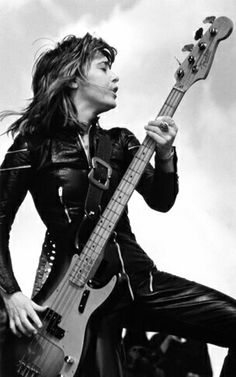 "Suzie Quatro, British-based American singer-songwriter & bass guitarist. ""The Wild One"", the raunchy rock ingénue smashing stereotypes & the charts in the 1970s. She had greater success in Europe & Australia than her American homeland. With her Bass Guitar & leather jumpsuit she smashed through stereotypes to the top of the charts in her own raunchy rock'n'roll way, and as the first female bass player to become a major rock star, possibly broke the barrier to women participating in rock…"